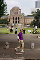 Older people city hiking in front of the Meiji memorial Picture Gallery in Shibuya, Tokyo, Japan Friday September 29th 2017