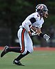 Manhasset No. 2 Ryan Damico races upfield during the first quarter of a Nassau County Conference II varsity football game against host Garden City High School on Saturday, September 12, 2015. He scored two touchdowns in defeat as Garden City won by a score of 38-14.<br /> <br /> James Escher