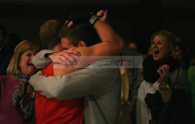 Alex Senn, left, is hugged by fraternity brother Brian Bodziony, right, after winning his bout at The Main Event at the Lexington Convention Center in Lexington, Ky., on Thursday, November 7, 2013. Photo by Tessa Lighty | Staff