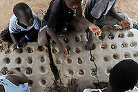 KENIA Fluechtlingslager Kakuma in der Turkana Region , hier leben ca. 80.000 Fluechtlinge ,  JRS JESUIT REFUGEE SERVICE Schule und trauma counselling / KENYA Turkana Region, refugee camp Kakuma, where 80.000 refugees live,  JESUIT REFUGEE SERVICE school and trauma counselling, Somali boy and woman