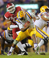 11/14/15<br /> Arkansas Democrat-Gazette/STEPHEN B. THORNTON<br /> Arkansas' DeMarcus Hodge sacks LSU's QB Brandon Harris on their first big drive in the second quarter during their game Saturday in Baton Rouge, La.