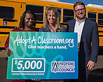 Jesse Marcus senior programs manager Propane Education & Research Council, right, presents a $5000 check to Principal Erin Lane,center and Washoe County Superintendent Traci Davis at the PERC Adopt a Classroom event at Lemmon Valley Elementary School on Tuesday, September 27, 2016