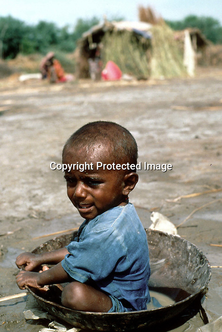 An unidentified malnourished baby in a camp for freed bonded slaves (haris) on July 28, 1996 in Matli, Pakistan. These untouchables of Pakistan are sold from  from land owner to land owner in Pakistan and are often abused by their owners..Photo: Per-Anders Pettersson/ iAfrika Photos