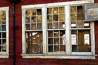 The afternoon sun creates distinctive colors and patterns on an old window at the Kennicott Mill in Alaska's Wrangell Saint Elias National Park.