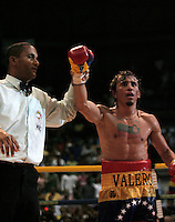 "Edwin Valero of Venezuela celebrates his victory against Mexican Héctor Velazquezfor the World-wide Council of Box (CMB), in Caracas,  December 20th 2009.Valero, famed for an impressive record of 27 straight knockouts and a huge tattoo of Chavez on his chest, hanged himself in his jail cell last week. The boxer, who was nicknamed ""El Inca"" in reference to an Indian warrior, committed suicide a day after he was arrested for murdering his 24-year-old wife."