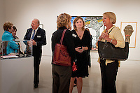 Art lovers attend the ribbon cutting ceremony to launch 'Cuba on My Mind', featuring over 30 works of Cuban art, on display at The von Liebig Art Center, Naples, Florida, USA, March, 10, 2011. Photo by Debi PIttman Wilkey
