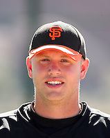 Seth Rosin #32 of the San Francisco Giants observes a minor league spring training game against the Oakland Athletics at the Athletics minor league complex on March 31, 2011  in Phoenix, Arizona. .Photo by:  Bill Mitchell/Four Seam Images.