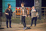 """© Joel Goodman - 07973 332324 . 19/12/2015 . Manchester , UK . A woman attempts to calm a man , seen shouting angrily and punching and kicking street furniture . Revellers in Manchester enjoy """" Mad Friday """" - also known as """" Black Eye Friday """" - the day on which emergency services in Britain are typically at their busiest , as people head out for parties and drinks to celebrate Christmas . Photo credit : Joel Goodman"""