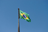 Brasilia, Brazil. Huge Brazilian flag (bandeira brasileira) flying over Praca dos Tres Poderes (Three Powers Square).