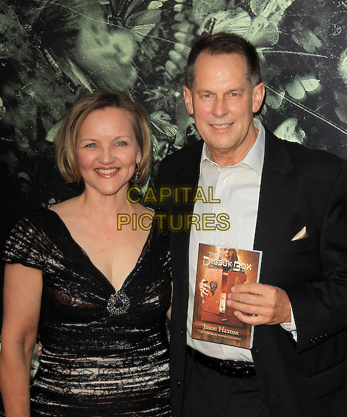 """guest & Jason Haxton.""""The Possession"""" Los Angeles Premiere held at Arclight Cinemas, Hollywood, California, USA..August 28th, 2012.half length suit book black white shirt dress  .CAP/ADM/KB.©Kevan Brooks/AdMedia/Capital Pictures."""