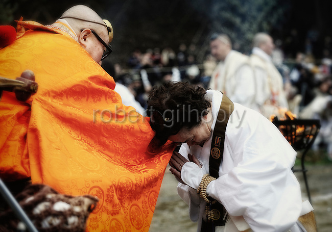 A pilgrim receives a blessing from the chief priest at a purification ceremony  in Takao, west of Tokyo, Japan on Sunday 09 March  2009. The ceremony culminates with dozens of monks and then pilgrims walking barefoot  across the burning embers.