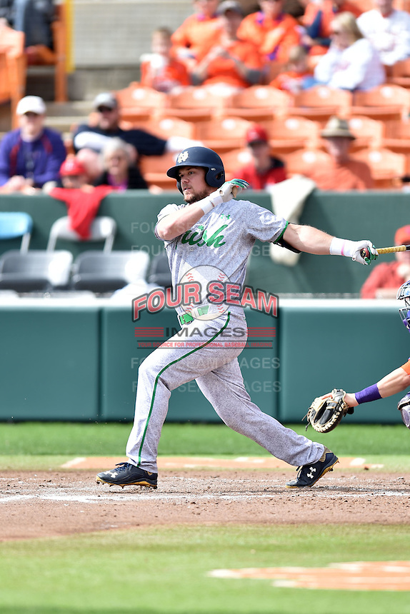 Notre Dame Fighting Irish designated hitter Ryan Bull (19) swings at a pitch during a game against the Clemson Tigers during game one of a double headers at Doug Kingsmore Stadium March 14, 2015 in Clemson, South Carolina. The Tigers defeated the Fighting Irish 6-1. (Tony Farlow/Four Seam Images)
