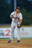 Danville Braves relief pitcher Marrick Crouse (30) looks to his catcher for the sign against the Burlington Royals at Burlington Athletic Stadium on August 9, 2019 in Burlington, North Carolina. The Royals defeated the Braves 6-0. (Brian Westerholt/Four Seam Images)