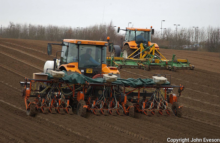 Drilling a 27 acre field of Nairobi carrots near Norwich for Graham and Mervyn Negus' Watton Produce based at Shropham, Attleborough, Norfolk. At one stage 12 tractors were involved with the operation, working down ridging, stone separating, bed forming, drilling, spraying, and finally covering with plastic.