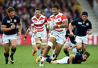 Amanaki Mafi of Japan in possession. Rugby World Cup Pool B match between Scotland and Japan on September 23, 2015 at Kingsholm Stadium in Gloucester, England. Photo by: Patrick Khachfe / Stewart Communications