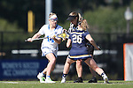 DURHAM, NC - FEBRUARY 26: Duke's Olivia Jenner (14) and Notre Dame's Sydney Flynn (26) contest a draw. The Duke University Blue Devils hosted the University of Notre Dame Fighting Irish on February, 26, 2017, at Koskinen Stadium in Durham, NC in a Division I College Women's Lacrosse match. Notre Dame won the game 12-11.