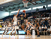 WASHINGTON, DC - FEBRUARY 22: Ayinde Hikim #0 of La Salle goes up between Armel Potter #2 and Chase Paar #3 of George Washington for  shot during a game between La Salle and George Washington at Charles E Smith Center on February 22, 2020 in Washington, DC.