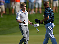 June 29, 2013  (Bethesda, Maryland)  James Driscoll greets Bill Hass as they finish Round 3 on the 18th hole at the AT&T National at Congressional Country Club. Driscoll and Hass share a four way tie atop the leaderboard going into the final round.  (Photo by Don Baxter/Media Images International)
