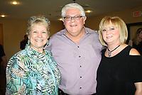 NWA Democrat-Gazette/CARIN SCHOPPMEYER Denise Garner, from left, and Johnny Bakker and Susan Chase visit at Peace at  Home.