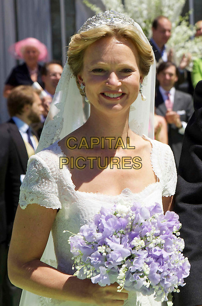 Carolina Princess Bride, Wedding of Albert Brenninkmeijer and Maria Carolina Princess de Bourbon de Parma, Basilica of San Miniato al Monte, Florence, Italy, 16 June 2012.royals royalty half length purple flowers bouquet white dress .CAP/PPG/JH.©Jens Hartmann/People Picture/Capital Pictures
