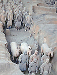 line of terra cotta warriors and horses in the main dig site of the Emperor Qin Shi Huang burial tomb outside Xian, China