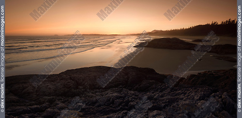 Pacific Rim National Park, panoramic twilight scenery in soft red light of the sandy ocean beach during low tide. Green Point, Tofino, Vancouver Island, BC, Canada. Image © MaximImages, License at https://www.maximimages.com