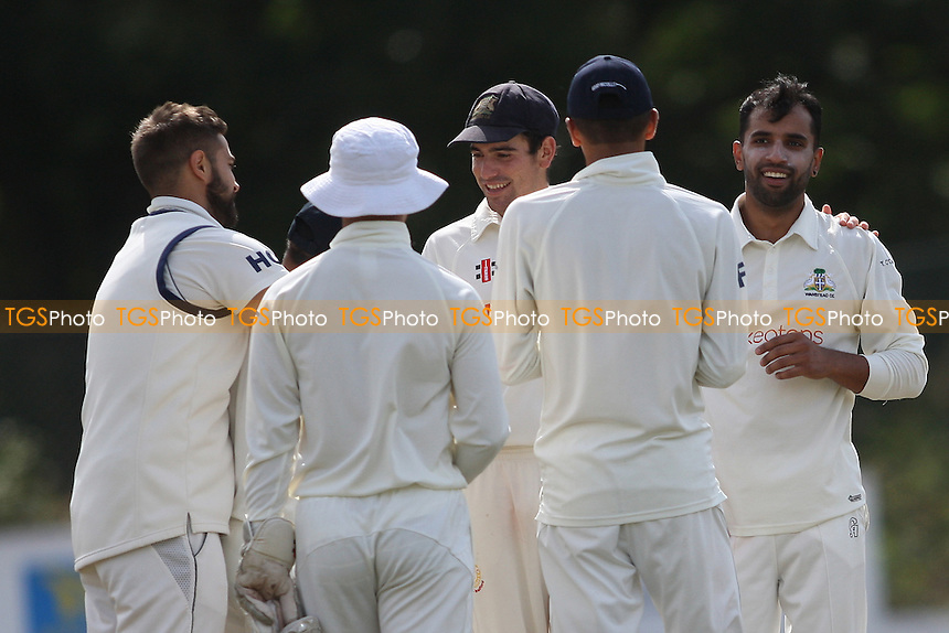 Zain Shahzad (right) of Wanstead takes his first wicket and celebrates during Wanstead and Snaresbrook CC vs Colchester and East Essex CC, Shepherd Neame Essex League Cricket at Overton Drive on 1st September 2016