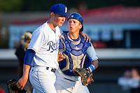 Burlington Royals relief pitcher Eric Sandness (37) puts his arm around catcher Chase Vallot (8) as they walk off the field between innings of the game against the Greeneville Astros at Burlington Athletic Park on June 30, 2014 in Burlington, North Carolina.  The Royals defeated the Astros 9-8. (Brian Westerholt/Four Seam Images)