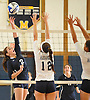 Plainview JFK No. 2 Joanna Savino, left, attempts to spike during a Nassau County varsity girls' volleyball match against host Massapequa High School on Wednesday, September 9, 2015. Massapequa won 25-21, 25-14, 25-16.<br /> <br /> James Escher