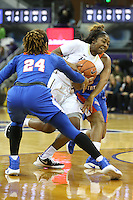 SEATTLE, WA - DECEMBER 18: Washington's #2 Aarion McDonald drives to the basket against Savannah State.  Washington won 87-36 over Savannah State at Alaska Airlines Arena in Seattle, WA.