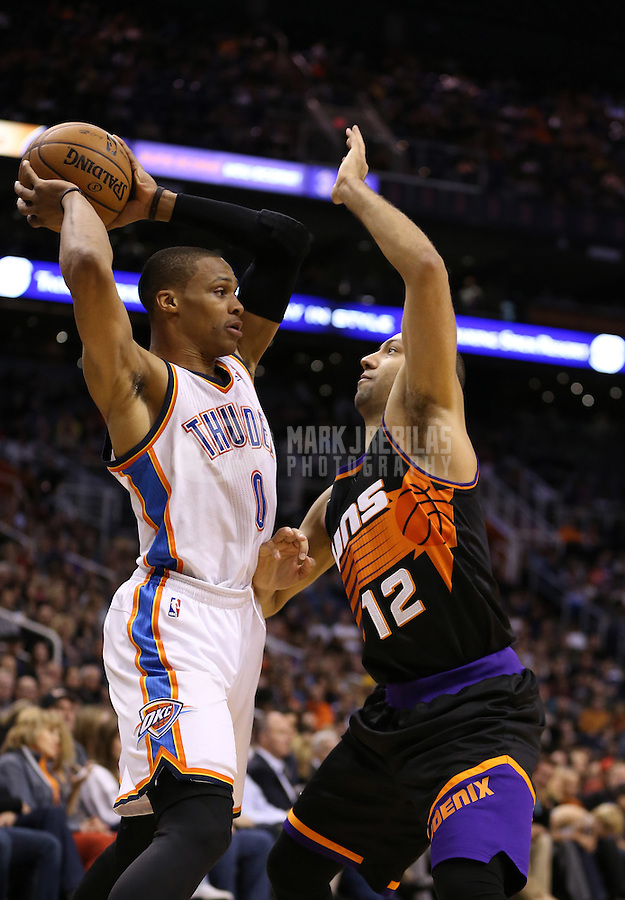Feb. 10, 2013; Phoenix, AZ, USA: Phoenix Suns point guard Kendall Marshall (12) defends against Oklahoma City Thunder point guard Russell Westbrook (0) at the US Airways Center. Mandatory Credit: Mark J. Rebilas-