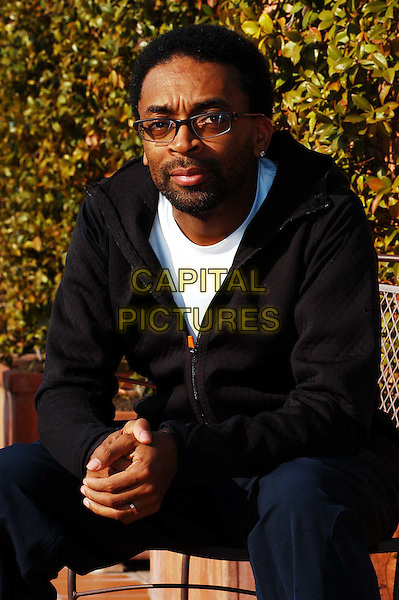 SPIKE LEE.3 December 2003.arms crossed, folded, half length, half-length, black top, glasses.www.capitalpictures.com.sales@capitalpictures.com.© Capital Pictures