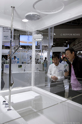 "December 13, 2012, Tokyo, Japan - Visitor and exhibitor see the shower system by TOTO. The Eco-Products Exhibition is one of the biggest environmental issues in Japan, drawing more than 180,000 business people and consumer exhibitors. The theme of this year is ""The Greener, The Smaller - The Future We Will Choose"", the exhibition will be held from December 13th to 15th in Tokyo Big Sight.(Photo by Rodrigo Reyes Marin/AFLO).."