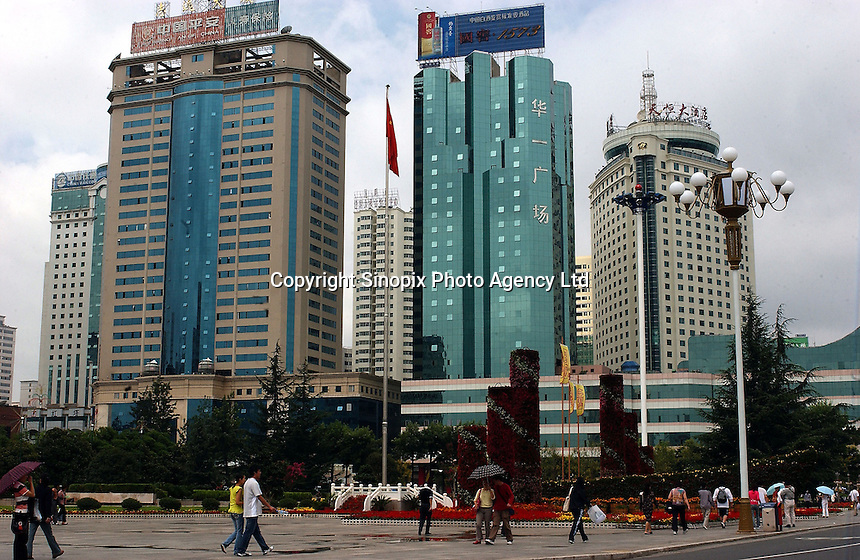 "The Kunming central business district, Yunnan, West China has undergone a face lift and been modernised as part of China's ""Go West"" policy where the economies of Western parts of China are opened up and stimulated.  ."