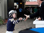 Feb 2011:  Anna Napravnik hands her goggles to a fan after winning the Mineshaft handicap at the Fairgrounds in New Orleans, Louisiana.