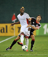 Dimitry Imbongo (92) of the New England revolution shield the ball against Dejan Jakovic (5) of D.C. United. The New England Revolution defeated D.C. Untied 2-1, at RFK Stadium, Saturday July 27 , 2013.