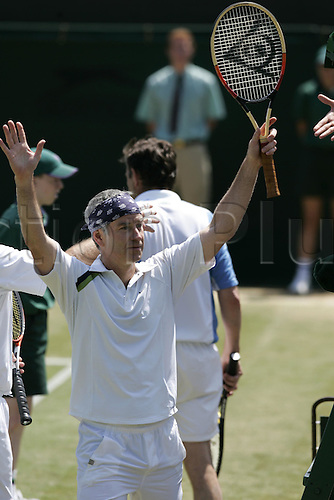 28 June 2005: American player John McEnroe (USA) playing in the Gentlemen's 45 And Over Invitational Doubles against Britons John Lloyd and John Feaver at the All England Lawn Tennis Championships, Wimbledon, London.. At McEnroe's side was his old partner and now fellow BBC commentator, Peter Fleming. They won four Wimbledon and three US Open crowns, among 42 assorted doubles titles, and were ranked No.1 in doubles for a total of 257 weeks. McEnroe and Fleming won the match 6-3, 6-4. Photo: Steve Bardens/Actionplus...050628.man mens men's