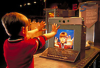 A robot draws the portrait of a boy at science exhibit. child, children. Pittsburgh Pennsylvania United States.