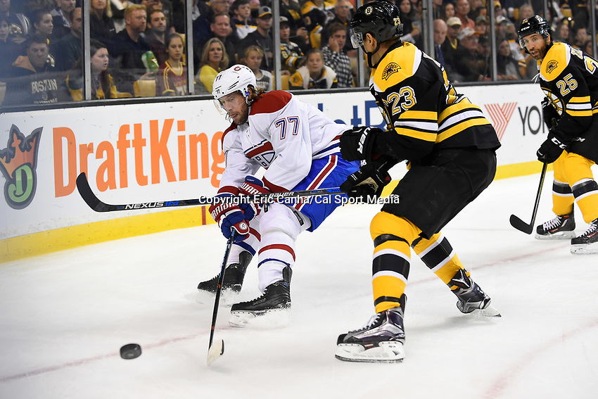 Saturday, October 10, 2105: Montreal Canadiens defenseman Tom Gilbert (77) work to keep the puck away from Boston Bruins center Chris Kelly (23) during the NHL game between the Montreal Canadiens and the Boston Bruins held at TD Garden, in Boston, Massachusetts. Eric Canha/CSM