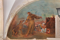 Mural, with St Francis and a dog, on the wall of the Cloister, built in late Romanesque style by Mihoje Brajkov of Bar in 1360, in the Franciscan monastery on Stradun or Placa, Old Town, Dubrovnik, Croatia. The city developed as an important port in the 15th and 16th centuries and has had a multicultural history, allied to the Romans, Ostrogoths, Byzantines, Ancona, Hungary and the Ottomans. In 1979 the city was listed as a UNESCO World Heritage Site. Picture by Manuel Cohen