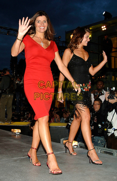 SUSIE VERRICO & IMOGEN THOMAS.Big Brother 2006 final.Borehamwood England, 18th August 2006.Ref: PL.full length black dress red hand waving.www.capitalpictures.com.sales@capitalpictures.com.©Phil Loftus/Capital Pictures