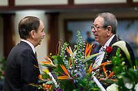 TALLAHASSEE, FLA. 1/12/16-Reps. Rep. Lake Ray, R-Jacksonville, left, and Rep. Ray Pilon, R-Sarasota, right, talk over the flowers on their desks during the opening day of the Legislature at the Capitol in Tallahassee. The House and Senate chambers are traditionally filled with flowers given by family and supporters of the lawmakers on the first day of session. <br /> <br /> COLIN HACKLEY PHOTO