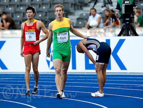 19 AUG 2009 - BERLIN, GER - Lehan Fourie (RSA) offers consolation to Andy Turner (GBR) after their 110m Hurdles Qualifying Round at the World Athletics Championships (PHOTO (C) NIGEL FARROW)