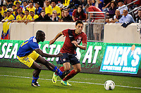 Clint Dempsey (10)  of the United States is defended by Segundo Castillo (14)  of Ecuador. The men's national team of the United States (USA) Ecuador (ECU) during an international friendly at Red Bull Arena in Harrison, NJ, on October 11, 2011.