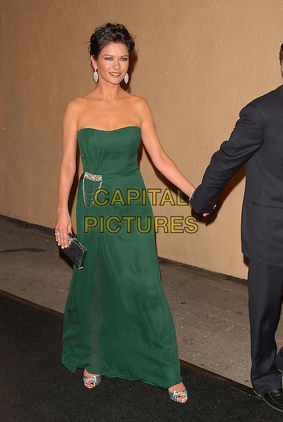"CATHERINE ZETA JONES .attends The 2nd Annual ""A Fine Romance"" to benefit The Motion Picture & Television Fund held at Sony Picture Studios in Culver City, California, USA, .October 20th 2007..full length  green strapless dress silver clutch bag purse holding hands                        .CAP/DVS.©Debbie VanStory/Capital Pictures"
