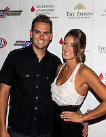 Aug. 29, 2013; Avon, IN, USA: NHRA top fuel dragster driver Leah Pruett (right) with fiancé Gary Pritchett on the red carpet prior to the premiere of Snake & Mongoo$e at the Regal Shiloh Crossing Stadium 18. Mandatory Credit: Mark J. Rebilas-