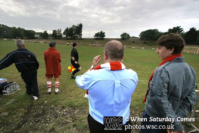 Spartans 2, Edinburgh City 0, 19/08/2006. City Park, East of Scotland League Cup. Spartans (white) take on Edinburgh City in an East of Scotland League Cup tie at City Park, Edinburgh. Spartans, perennial Scottish Cup giant killers, are due to relocate to a new purpose-built stadium in 2007 bringing to an end football at the north Edinburgh ground which was built, ironically, by Edinburgh City, who now play at the Commonwealth Stadium, the former home of Meadowbank Thistle. City were members of the Scottish League in the 1930s. Spartans won this group match 2-0. Here Spartans fans get close to their manager Mike Lawson (red top). Photo by Colin McPherson.