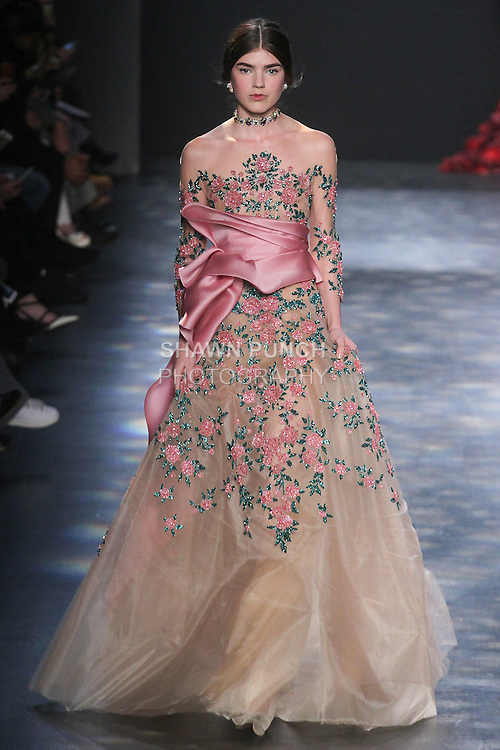 Model Skylar walks runway in a nude tulle ball gown with raspberry pink and emerald 3D encrusted floral embroidery and removable rose sating-faced organza drape, from the Marchesa Fall 2016 collection by Georgina Chapman and Keren Craig, presented at NYFW: The Shows Fall 2016, during New York Fashion Week Fall 2016.