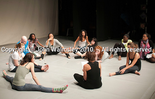 Dance students at the end of  rehearsal for end of year show receiving notes from their director, Kingston College.