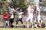 Palos Verdes, CA 09/27/13 - Tobi Ibraheem (Peninsula #5), Julius Lagmay (Peninsula #37), Richard Rivera (Lawndale #4) and Chris Guzman (Lawndale #51) in action during the Lawndale vs Palos Verdes Peninsula Varsity football game at Peninsula High School.